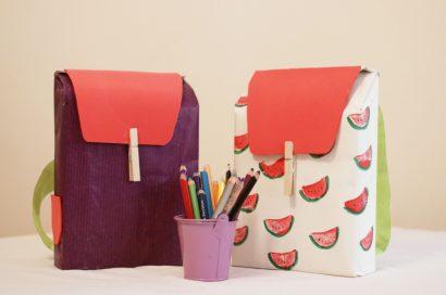 arbūzais dekoruotos dėžutės kuprinės formos, pieštukai pieštukinėje